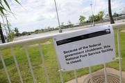 A sign outside the USS Arizona Memorial at Pearl Harbor lets visitors know the facility, part of the World War II Valor in the Pacific National Monument, was closed Tuesday because of the federal government shutdown.