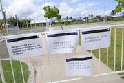 Signs in English, Chinese and Japanese let visitors to Pearl Harbor know that the World War II Valor in the Pacific National Monument was closed Tuesday due to the federal government shutdown.