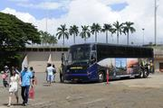 Tourists arrive by bus at Pearl Harbor to visit the Battleship Missouri Memorial and the Pacific Aviation Museum Pearl Harbor Tuesday. The other sites at Pearl Harbor, including the USS Arizona Memorial, were closed because of the federal government shutdown.