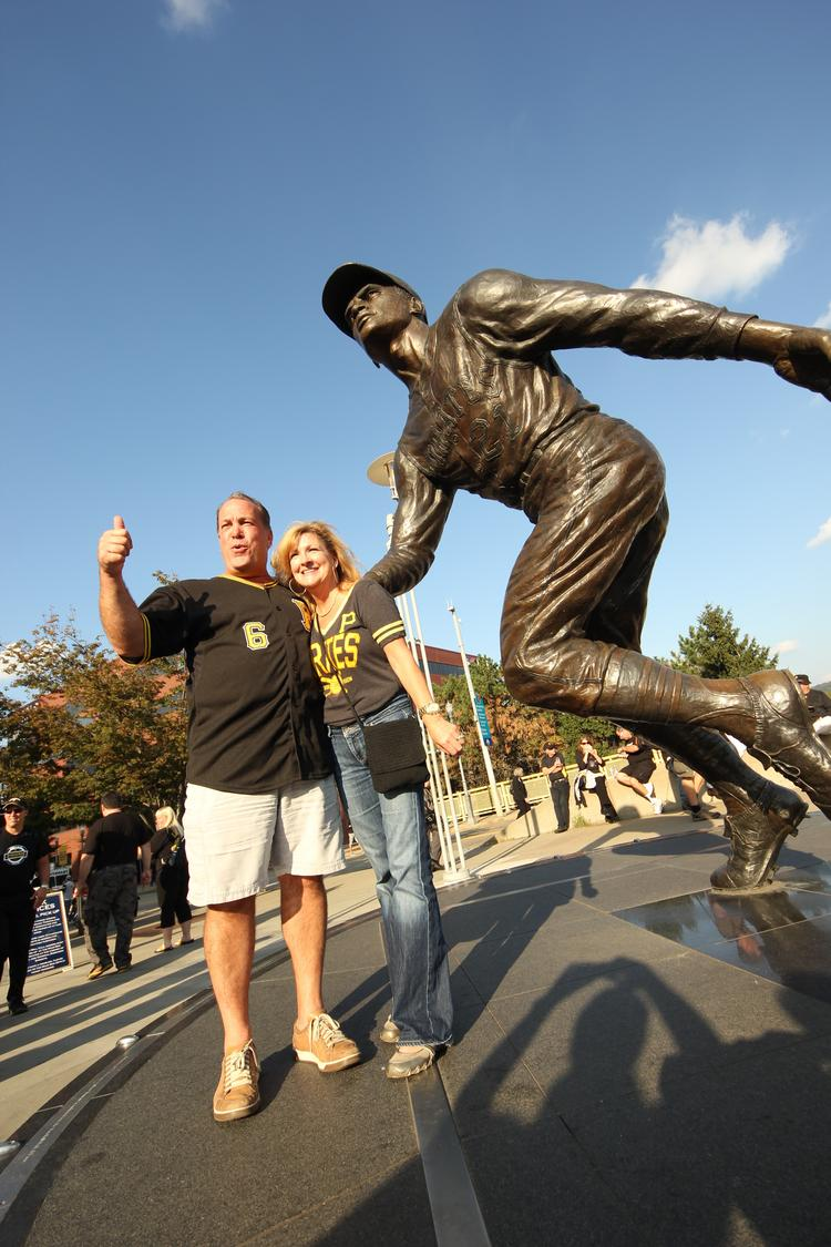 Ron and Payge Sofranko of Wexford pose with the Roberto Clemente Statue outside PNC Park before Tuesday night's game.