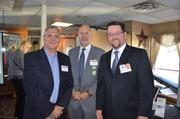 From left: Jim Palya, sales director at W5Templates, Bob Schmitt, executive director of BNI, and Hank Compernolle Jr., president of Universal Solutions Group.
