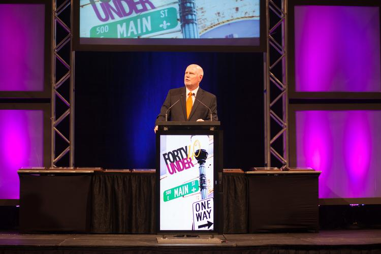 Business First publisher Tom Monahan is shown speaking at this year's Forty Under 40 event, which was held last week at the Kentucky International Convention Center.