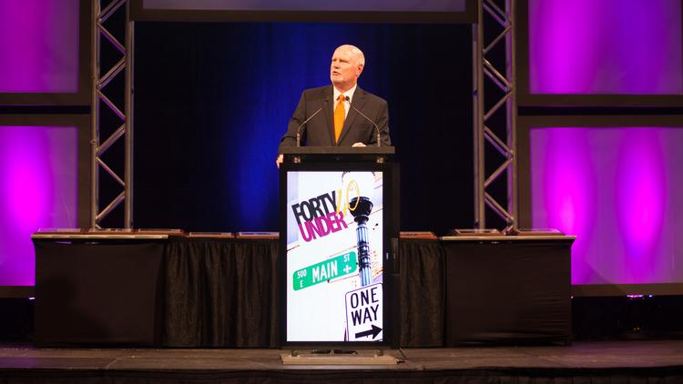 Business First publisher Tom Monahan is shown speaking at last year's Forty Under 40 event, which was held at the Kentucky International Convention Center.