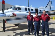 The EagleMed Crew (from left) of Duane Jones, Cathy Heikes and Troy Jantz, stand with one of the company's Beechcraft King Airs.