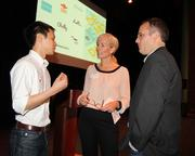 Mike Bott, right, talks with Suzanne Tosolini and  Ricky Phung, who presented during Demo Day.