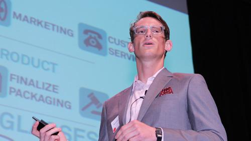 Konrad Billetz of Frameri gives a presentation to investors while wearing the glasses the company is selling.