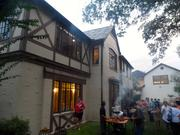 Backyard of Hobby Manor. Guests milled around as dinner grilled.