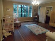 The home's nursery is one of six bedrooms.