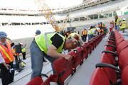 A wide-angle view of crews at Levi's Stadium installing seats in the 68,500-seat venue's lower level.