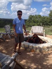 Eric Goldreyer, one of the new investors, checks out the fire pit.