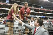 Michael Bidwill, president of the Arizona Cardinals, shakes hands with fans before the season-opener against the Detroit Lions last month.
