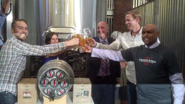 Toasting the Oct. 4 start of Denver Beer Fest are (l to r): Chad Yakobson, owner of Crooked Stave Artisan Project; Julia Herz, craft beer program director for the Brewers Association; Richard Scharf, president/CEO of Visit Denver; Kyle Zeppelin, developer of The Source marketplace; and Denver Mayor Michael Hancock.
