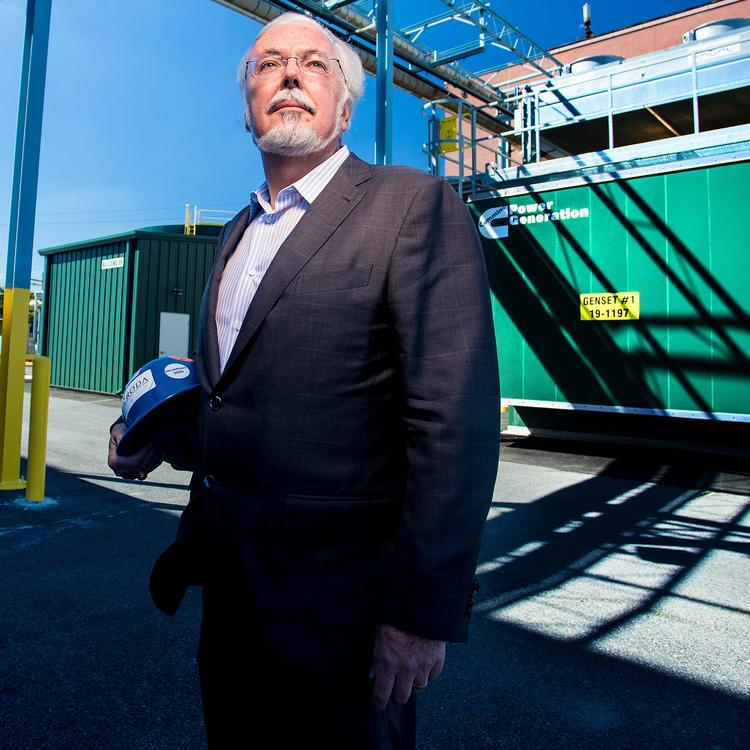 Kevin Gallagher stands outside an electric generator at Corda's Delaware plant.