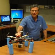 They're not just for the military. Richard Evans of SpawGlass shows off one of the drones.