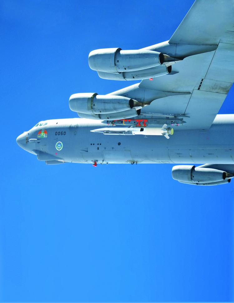 A B-52 bomber carries a scramjet test vehicle in May. Raytheon is now working on a scramjet cruise missile that might fly Mach 5.