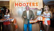 Pruitt is pictured here at the opening of the first Hungarian Hooters in Budapest a year ago. Chanticleer has opened six Hooters restaurants in three countries, and it plans to add four more by the end of the year.