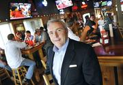 Mike Pruitt sits on the board of directors at Hooters of America. He is also founder and CEO of Chanticleer Holdings, an international franchisee of Hooters restaurants.