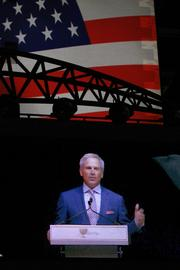 Fred Couples, captain of the American team, appears on a giant screen during his opening address.