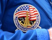 McBride wore his mission patch for the discussion.