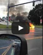 A screenshot from the Tesla fire video. Go to bottom of story to see the video.