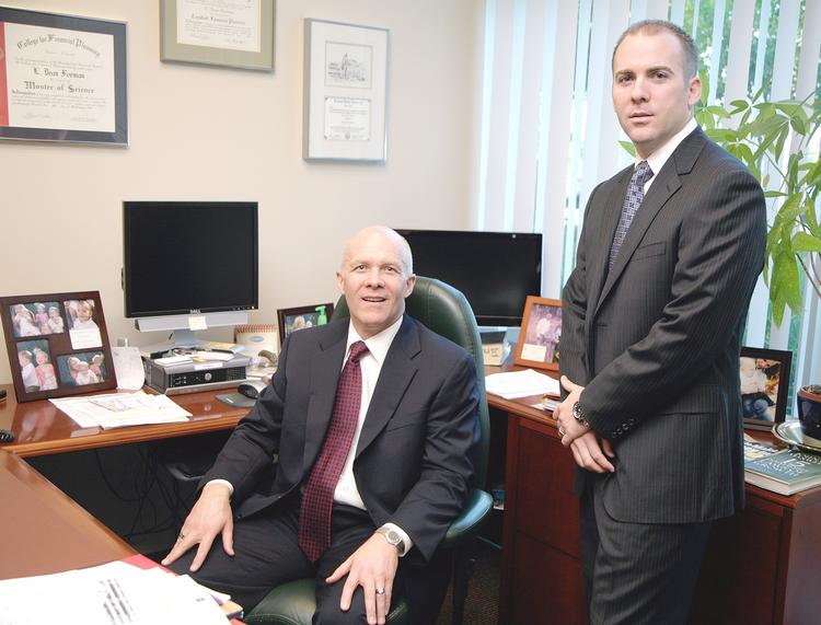 Dean Forman, left, and Jared Forman of GFBB Insurance are spending a lot of time helping clients navigate through the ins and outs of the Affordable Care Act.