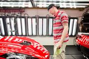"""Mark Cox, nicknamed """"Spider,"""" at the plant spot checks the car in the detail department."""