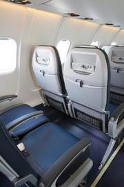 The new seat includes additional seat-back storage.