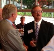 Bill Tate, founding member and partner at the Howard Tate law firm (right) visits with Ric Miller, chairman of Willis of Tennessee, Inc. during the event.