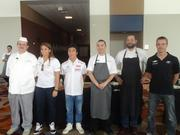 From left to right: Gerhard Schaefer, a chef at Roland's Swiss Pastry & Bakery;  IZOD IndyCar Series driver Simona De Silvestro; Sato; Manabu; Jean-Philippe Gaston, chef de cuisine at Haven and Cove; and IZOD IndyCar Series driver Sebastien Bourdais