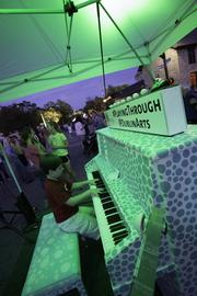 """The """"Playing Through street piano"""" was set up at the center of the blocked-off intersection at Bridge and High, encouraging anyone to play. Nathan Smith, 11, showed off his chops for the crowd."""
