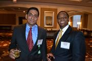 Narayan Partangel, left, from No. 42 NeuStar Inc., with David White from Wells Fargo.