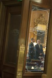 Employees prepare for the day at Churchill Bar in The Brown Palace Hotel.