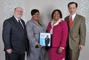 Minority Business Leader honoree DeRionne Pollard, second from left, president of Montgomery College, with her guests.