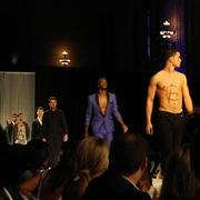 Sporting Kansas City forward CJ Sapong (center) models a blue tuxedo sans shirt for teammate Aurelien Collin's AC78 fashion show.