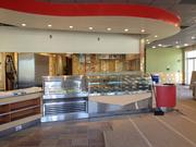 A curved ceiling accent, complementary colors and new tile floors are all part of the Krispy Kreme 2013 design standards, which are all new to the renovated store near The Mall at Millenia.