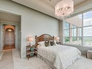 Maryland: The master bedroom features two walls of windows.