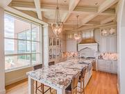 Maryland: The kitchen ceilings are coffered, and the center island is equipped with a 48-inch Wolf range, two 27-inch sub-zero refrigerators, a hammered copper nickel plated farm sink and a matching hood.