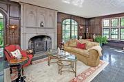 Brentmoor: The living room is paneled, and has a limestone fireplace.