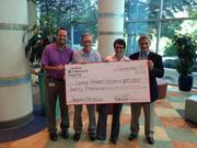 "CBJ Seen: Joedance Film Festival founders Diane Restaino (second from right) and Mike Restaino (right) present a $20,000 check for Levine Children's Hospital for rare pediatric cancers research to LCH oncologists Dr. Javier Oesterheld (left) and Dr. Daniel McMahon earlier this month. Joedance, now in its fifth year, raises money for pediatric cancers research at Levine Children's Hospital with an August weekend festival and other events throughout the year. Photo by Dave Park.Want to see your events featured? Send photos and caption info in an email to aangel@bizjournals.com with ""CBJ Seen"" in the subject line."