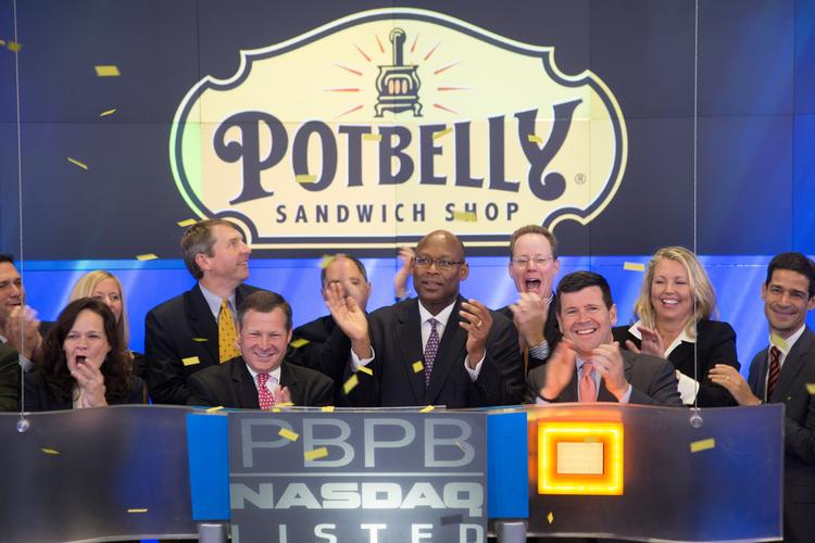 Potbelly executives rang the opening bell on the NASDAQ exchange this morning to celebrate the sandwich chain's initial public offering.  Bryant Keil and Aylwin Lewis are second and third from the left respectively in the front row.
