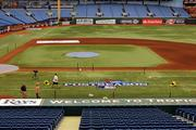 The postseason logo done along the first base line.