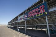 Behind the grandstands at Wild Horse Motorsports Park a banner advertises one of the facility's upcoming events.