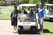 Kenny Ching, left, executive manager and vice president of operations for Pacific Honda, and Brent Helgeson, senior vice president and division manager dealer division for First Hawaiian Bank, participate in Acura of Honolulu's 3rd Annual Ai on Japan fundraiser golf tournament at the Honolulu Country Club. Funds raised from the tournament benefit benefit Japan earthquake and tsunami victims through Kids Hurt Too Hawaii.