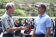 From left, Dan Dinell, vice president of sales and marketing at Hilton Grand Vacations, and Todd Apo, director of public affairs at Aulani a Disney Resort & Spa, prepare to golf at the Mid Pacific Country Club for the American Resort Development Association of Hawaii's ninth annual Steve Hirano Memorial Classic Golf Tournament. Proceeds benefit the Steve Hirano Memorial Scholarship Fund for outstanding travel industry management students at Hawaii Pacific University.