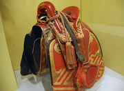 A 19th century saddle made from wood, leather and gold lacquer.