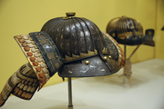This helmet from the 17th century is made with iron and leather and its inlaid silver design is a testament to the skill of the craftsmen of the time.