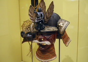 A helmet and mask from the mid-16th century made of iron, wood, leather and lacquer.