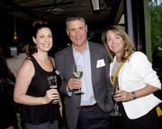 Justine Roller, Account Executive, Entercom Radio; Sean Shannon, General Manager, Entercom Radio and Lindsay Wagner, Account Executive, Entercom Radio, pose at the Alliance for Women in Media awards.
