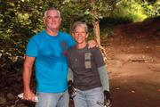 Linda Howe, right, community relations director for Alexander and Baldwin, with her husband, Jim, volunteer their time to help preserve Moanalua Valley, along with eight other sponsors, such as HECO, Central Pacific Bank and Makai Ocean and Engineering, who joined The Trust for Public Land during a community workday in Moanalua Valley. Volunteers cleared trails of leaves, branches and muddy debris strewn by recent high winds and rain, dispersed gravel along the trail paths, and cleaned graffiti off stone bridges.