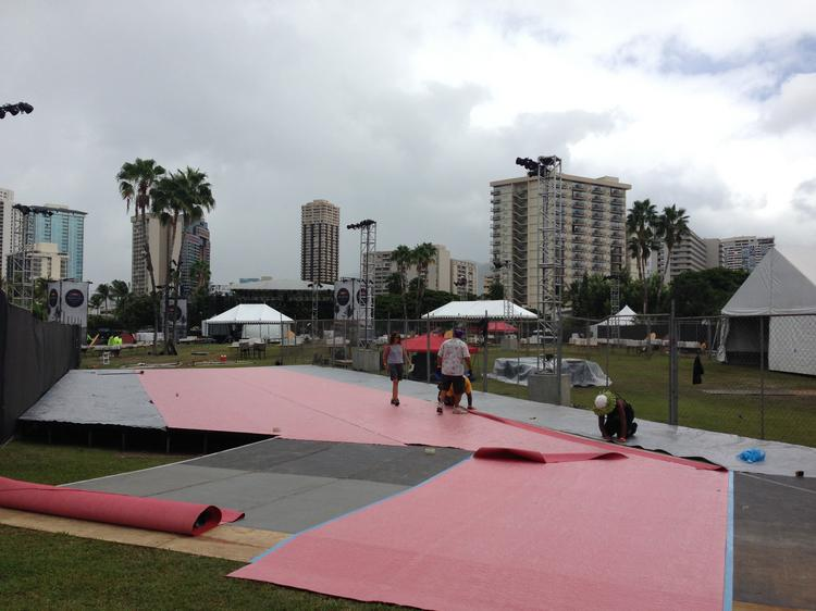 Workers set up a stage at Kuroda Field in Fort DeRussy in Waikiki where Oracle Corp. is sponsoring a private Stevie Wonder concert for its employees Saturday night.